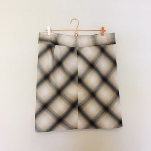 The limited plaid skirt
